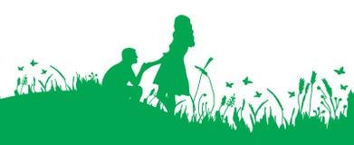 Пары на траве Стоковая Фотография