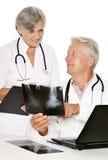 Пары доктора работая на таблице Стоковое Изображение RF