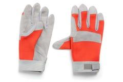Пары перчаток, красного цвета и серого цвета предохранения от работы Стоковые Фото