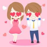Пары принимают сердце и усмехаются Стоковые Фото