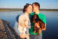 Пары с их собаками Стоковое Изображение