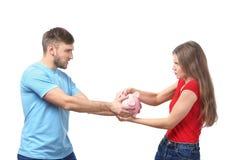 Пары с копилкой на белой предпосылке Стоковое фото RF