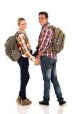 Пары с рюкзаками Стоковые Фотографии RF