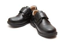 Пары черного кожаного ботинка для детей Стоковое Фото