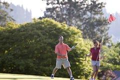 пары golf играть Стоковые Изображения RF