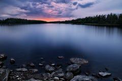 Пасмурный заход солнца Стоковые Изображения