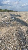 Пасмурный пляж дня Стоковая Фотография RF