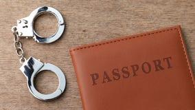 Паспорт и наручники сток-видео