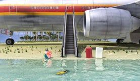 Пассажирский самолет и пляж Стоковое фото RF