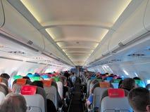 Пассажиры, кабина и места самолета Стоковая Фотография