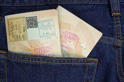 Пасспорты в карманн Стоковое фото RF