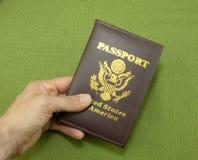 Пасспорт в руке Стоковые Изображения