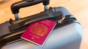 Пасспорт на чемодане Стоковая Фотография