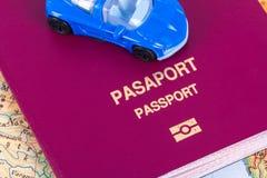 Пасспорт с автомобилем игрушки Стоковые Фотографии RF