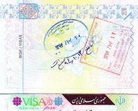 Пасспорт с штемпелями визы, входа и выхода Ирана Стоковая Фотография