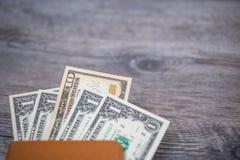 Пасспорт Таиланда и куча денег доллара США Стоковое Изображение
