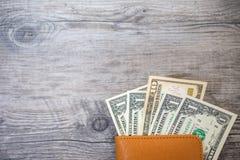 Пасспорт Таиланда и куча денег доллара США Стоковая Фотография