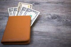Пасспорт Таиланда и куча денег доллара США Стоковые Изображения