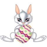 пасхальное яйцо держит кролика Иллюстрация вектора
