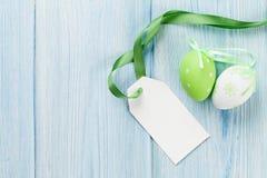 Пасхальные яйца и пустой ярлык бирки Стоковое фото RF