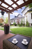 Патио дома с таблицей ротанга Стоковое фото RF