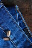 Патроны на джинсовой ткани Стоковое Изображение RF