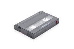 патрон данным по резервной копии ленты компьютера 8mm над белой предпосылкой Стоковая Фотография