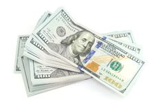 Пачка 100 долларов изолированных на белизне Стоковая Фотография