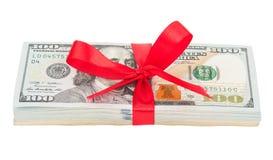 Пачка долларов США связанных с красной лентой Стоковое Изображение