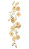 Падая куски банана изолированные на белой предпосылке Стоковые Изображения