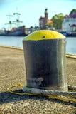 Пал в морском порте с парусным судном Стоковое Фото