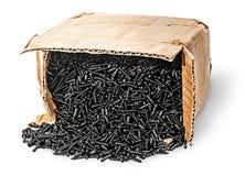 Падение винтов из старой картонной коробки Стоковые Изображения