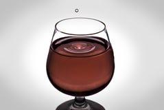 Падение воды в вине Стоковое фото RF