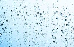 Падение воды на стекле Стоковые Изображения