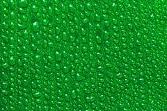 Падения воды на зеленых лист банана Стоковое Изображение