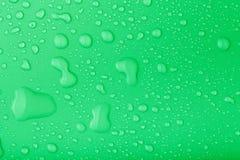 Падения воды на предпосылке цвета тонизировано стоковые фотографии rf