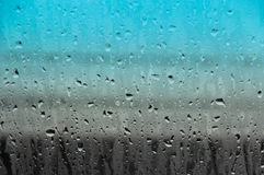 Падения воды на стеклянной предпосылке конспекта текстуры Стоковые Фото