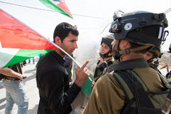 Палестинский протест и израильские воины Стоковая Фотография RF