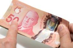Палец указывая 50 долларов Стоковая Фотография