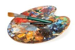 Палитра художника с paintbrushes Стоковое Изображение RF