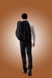 Пальто владением бизнесмена стоковое фото rf