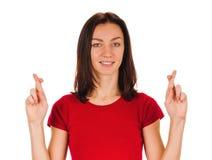 Пальцы скрещивания женщины Стоковая Фотография RF