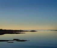 Пейзаж пляжа после захода солнца Стоковое Фото
