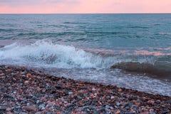 Пена волны моря на пляже Стоковые Фото