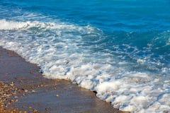 Пена волны моря на пляже Стоковая Фотография RF