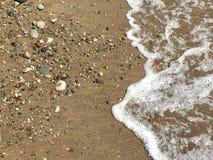 Пена и камешки воды Стоковая Фотография