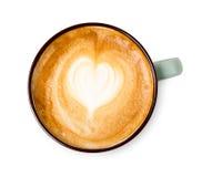 Пена капучино, взгляд сверху кофейной чашки на белой предпосылке Стоковое фото RF