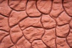Первоначально красная предпосылка при декоративный булыжник покрытый с цементом стоковые изображения rf