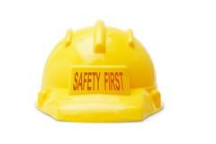 первый желтый цвет безопасности hardhat Стоковые Фото