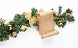 Пергамент рождественской открытки над елью Стоковая Фотография RF